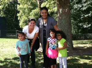 Office of Head Start's Colleen Rathgeb and ECMHSP's Parksley Center Director LaShundra Weeks with children from farmworker families.