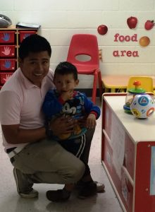 Family Service Coordinator Jose Ramos greeting a child on the first day.