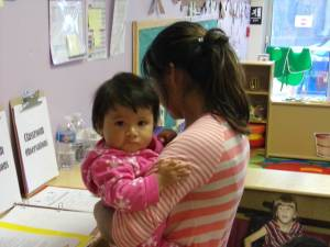 Farmworkers enroll their children for Head Start services at the Field of Dreams center.