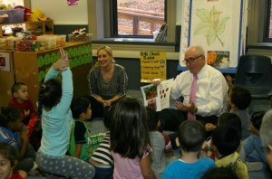 Representative Mike Kelly sits down with children in ECMHSP's Head Start program to read a book.
